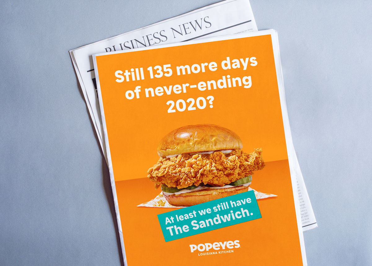 Popeyes chicken sandwich image on a newspaper