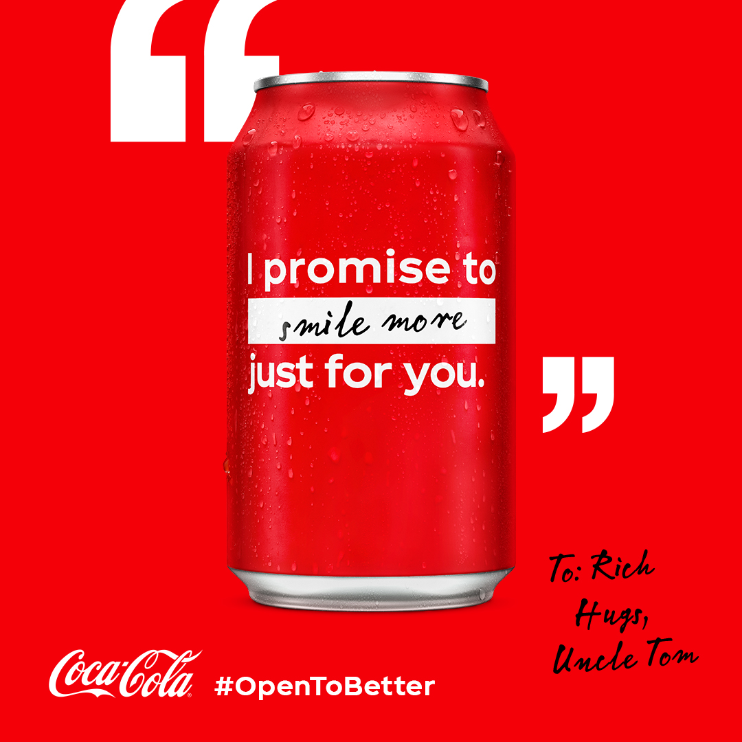 Coke can with the 'Smile more' resolution written on it.
