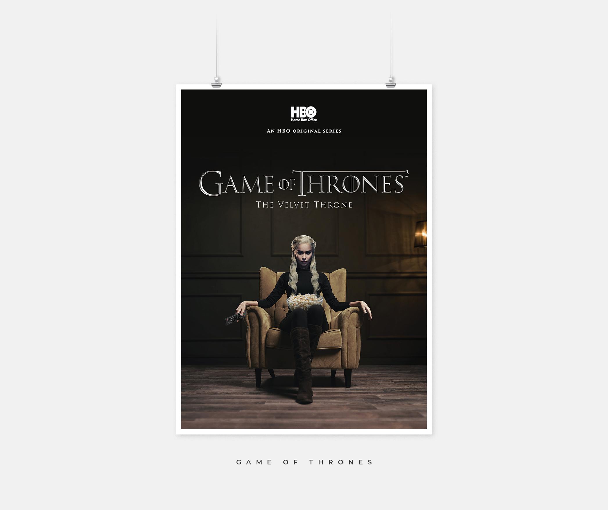 Game of Thrones poster with a Daenerys look alike sitting on a couch.