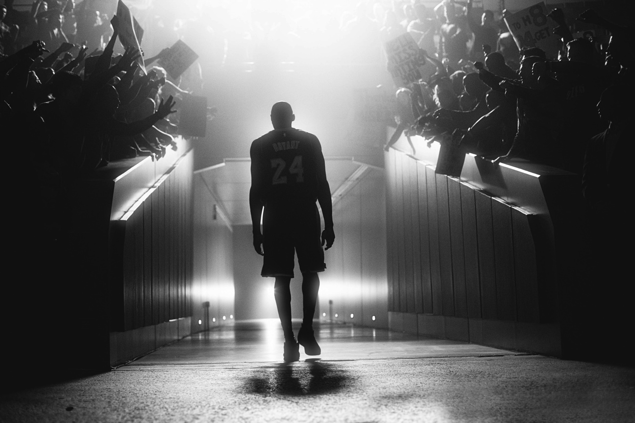 Kobe Bryant shown walking out of a stadium.