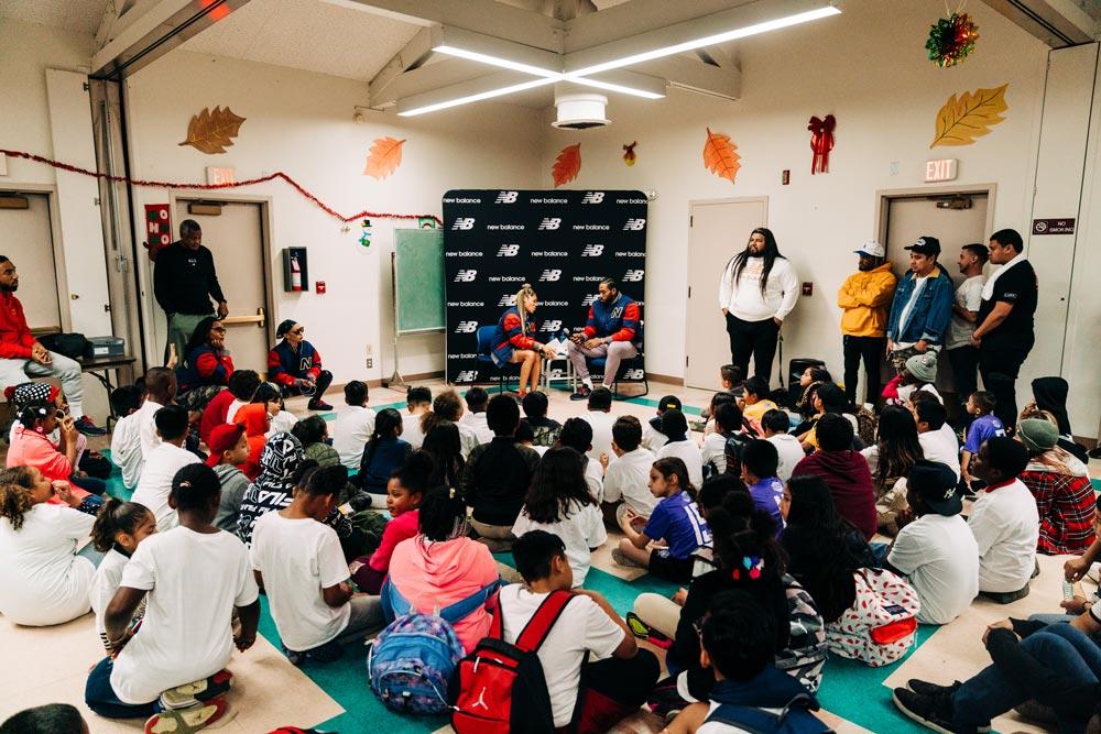 Crowd of children and adults gathered to listen to Kawhi Leonard and Samia Akbar