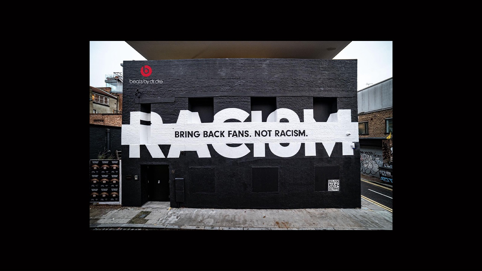 """Wall with text, """"Bring back fans not racism."""""""