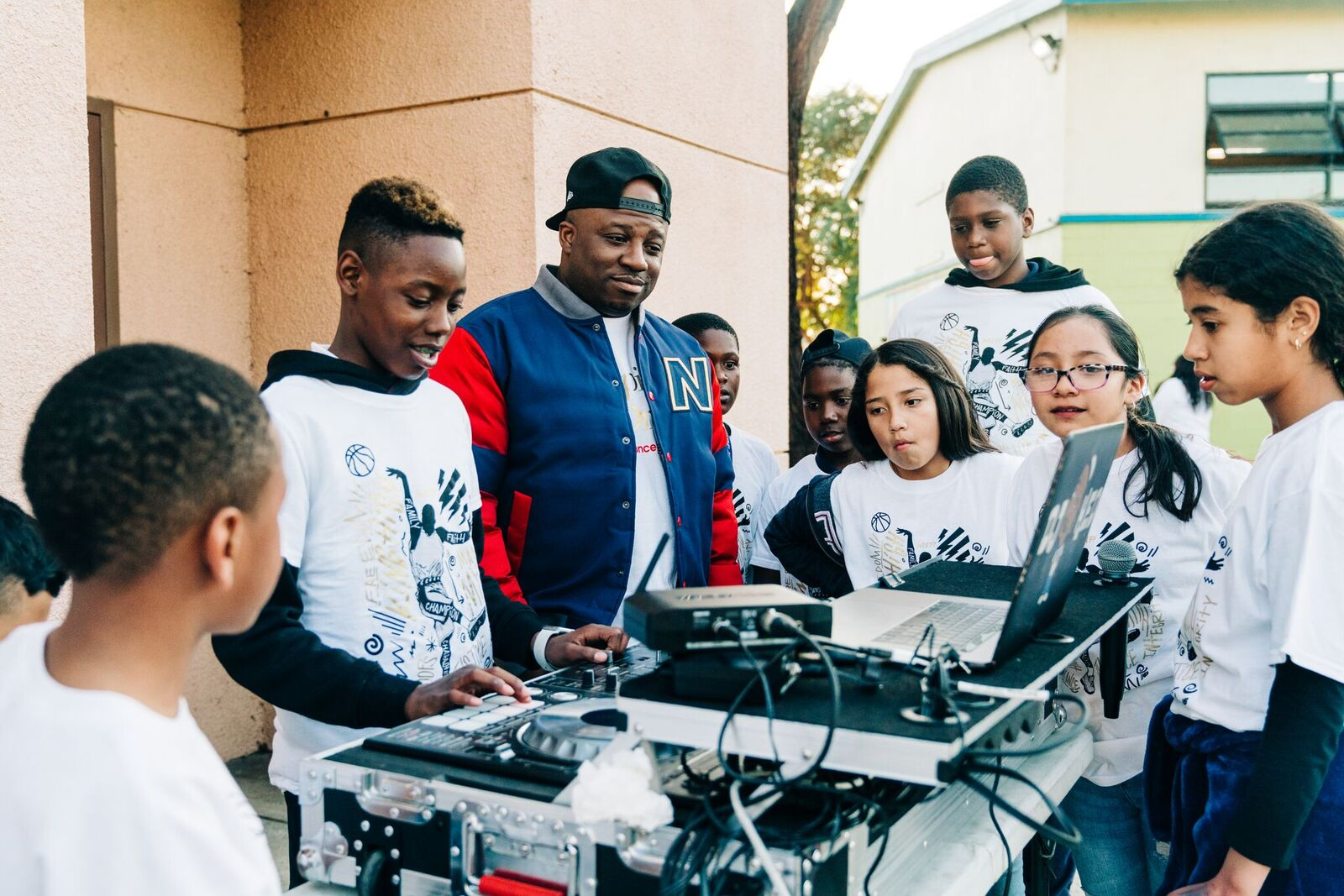 Child dj'ing while other kids watch