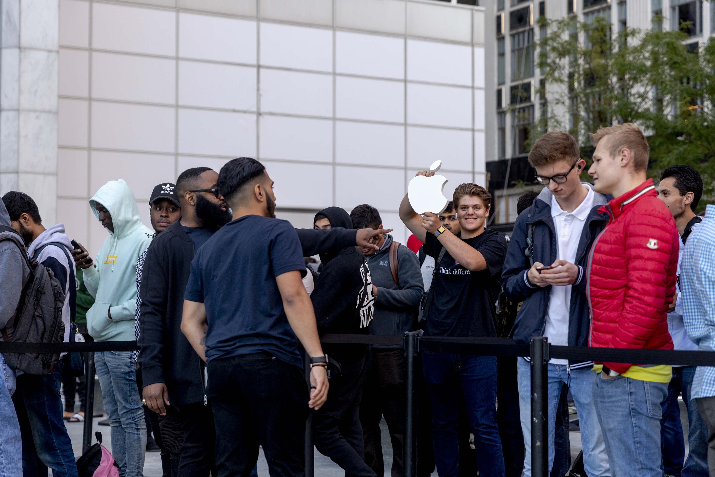 Apple's new iPhones show signs of healthy demand; remodeled NYC flagship draws crowds