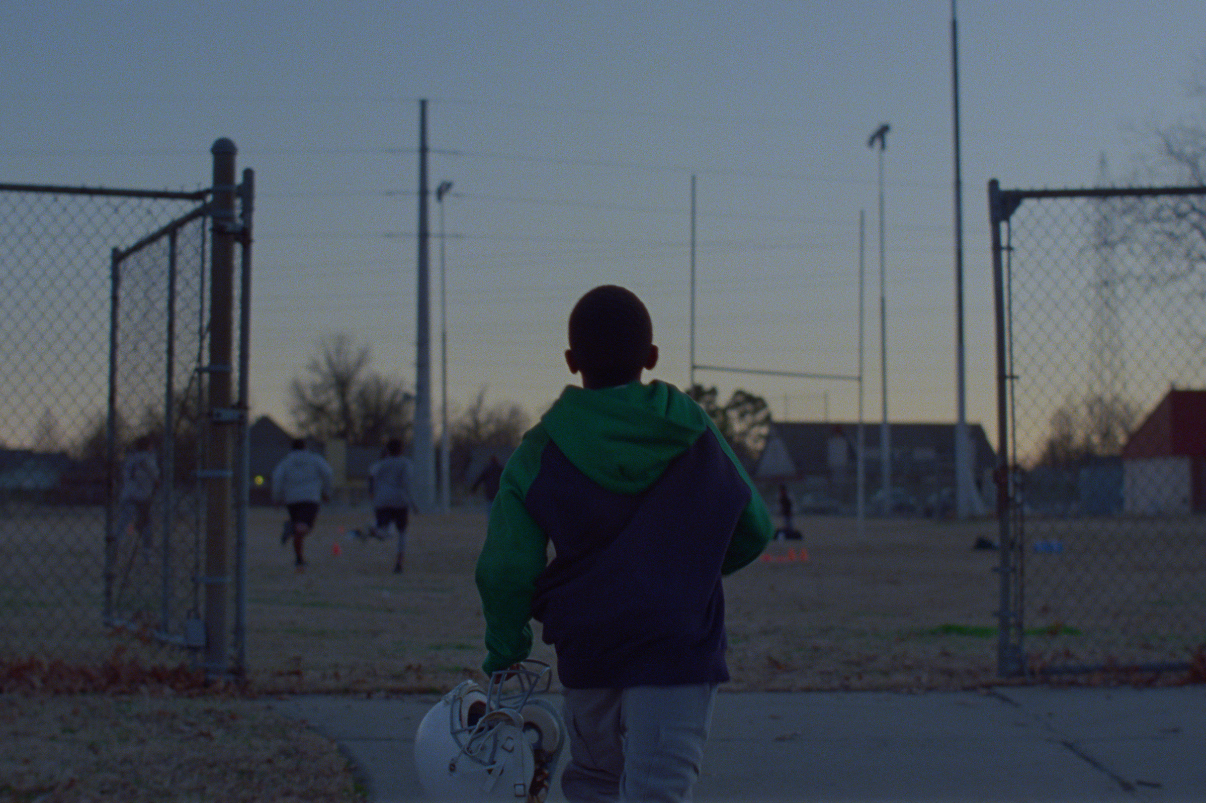 Kia's Super Bowl ad shows NFL star Josh Jacobs talking to his younger self about growing up homeless