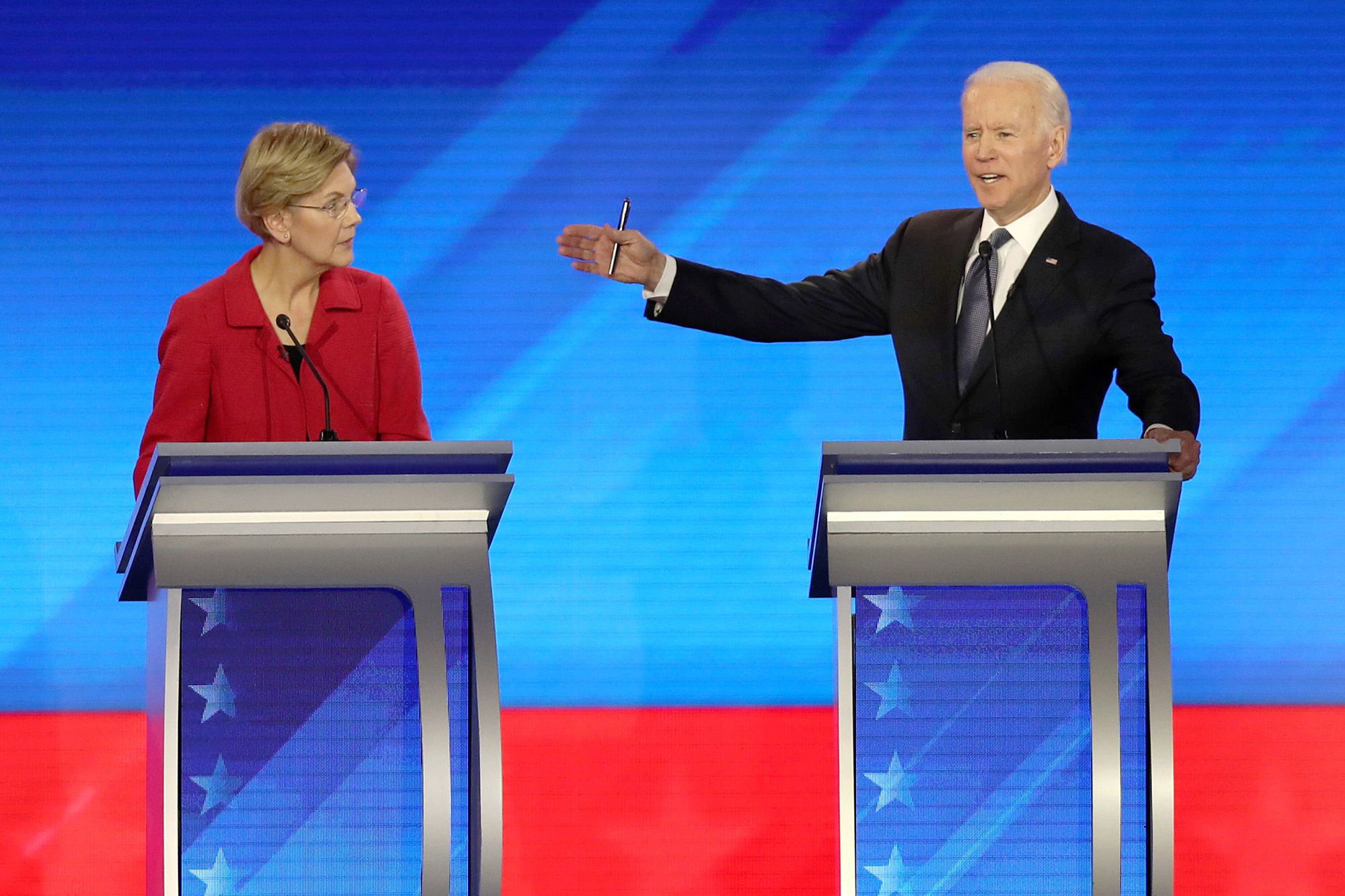 Iowa laggards Joe Biden and Elizabeth Warren shift ad spending to stay in the race