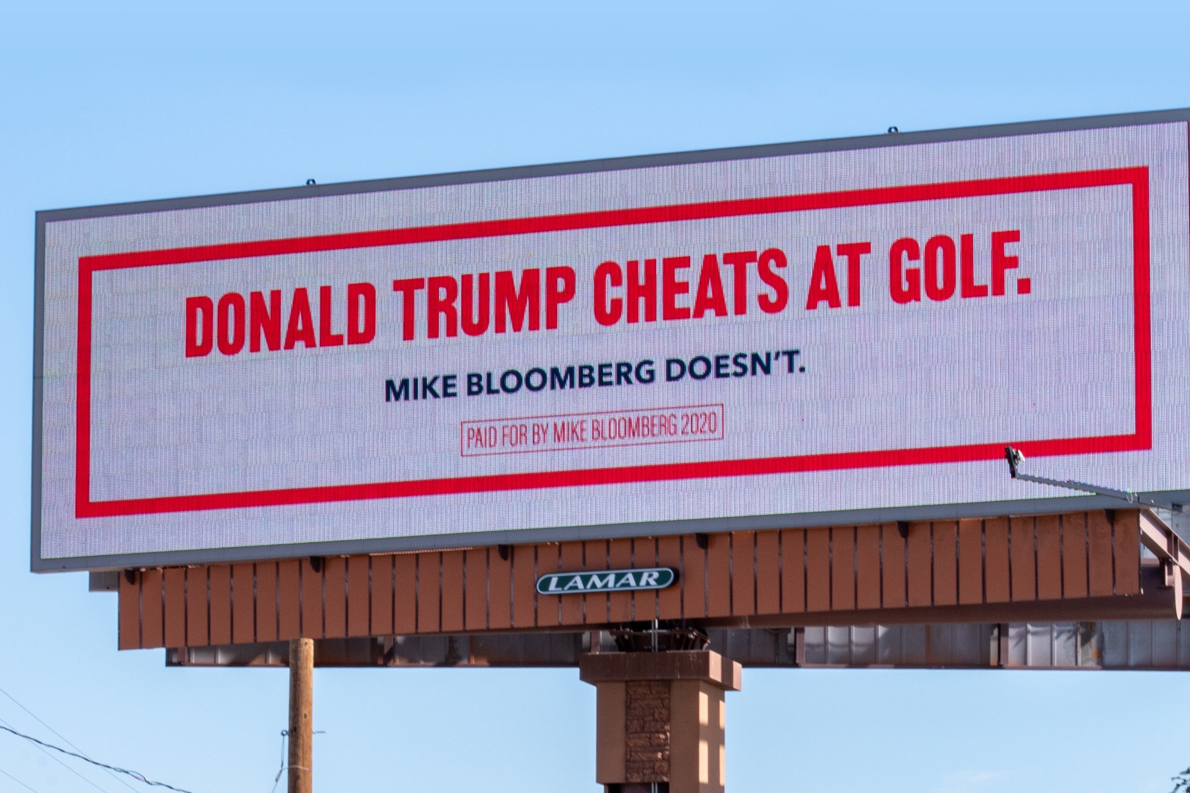 Bloomberg trolls President Trump with mocking billboards, but they backfire as memes