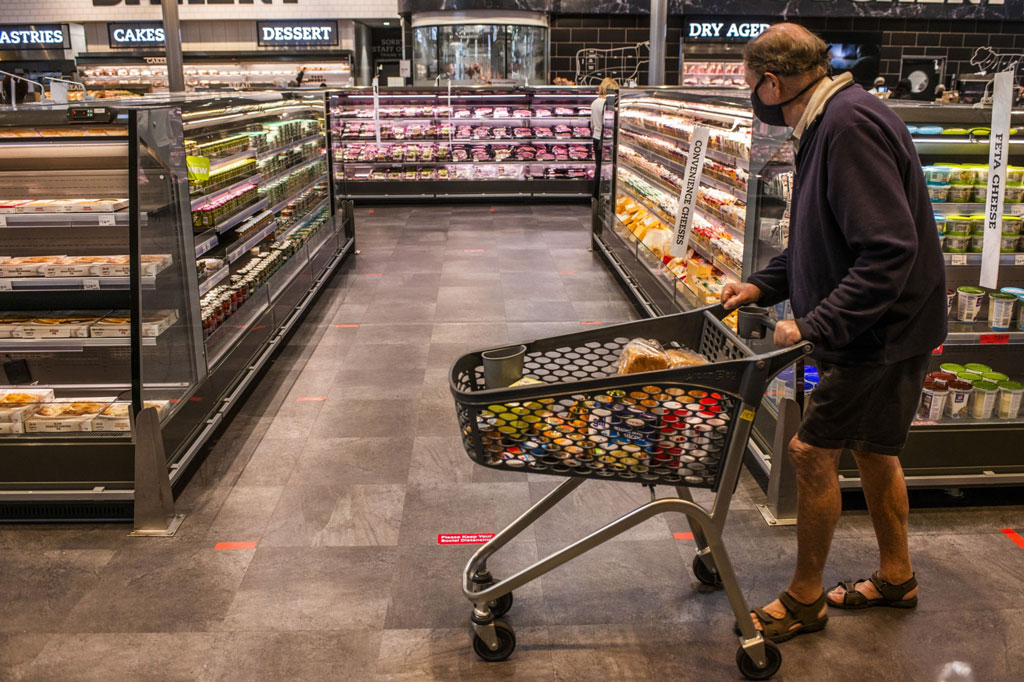 U.S. consumer spending plunges while stimulus boosts incomes