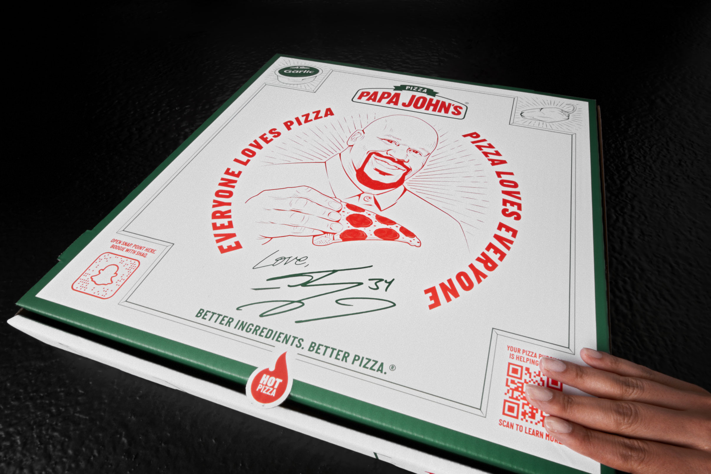 Papa John's shows off Shaq's XL pizza in a charitable campaign