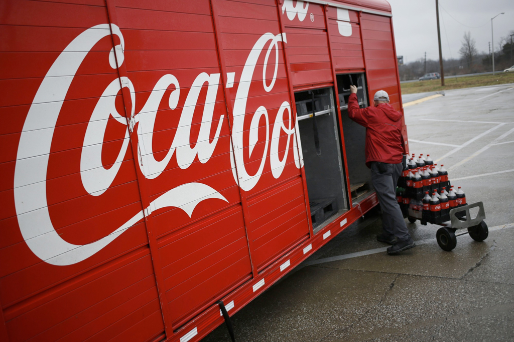 Coke inches back as CEO notes world still in 'fragile state'
