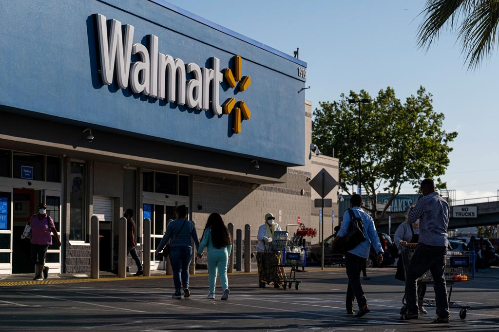 Walmart jumps as 'get out and shop' ethic spurs boosted forecast