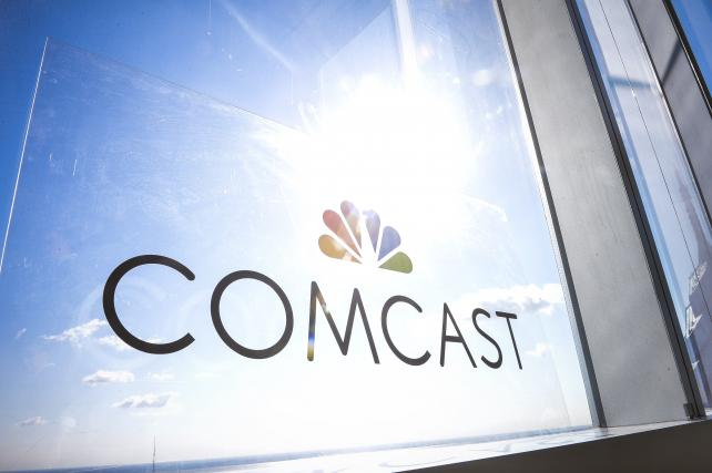 Comcast boosts Sky bid, topping Fox offer in global standoff