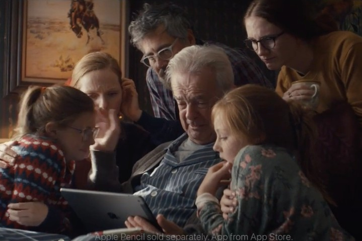 Apple's new holiday commercial may leave you weeping over an iPad. Plus news about the Super Bowl, Amazon and Netflix