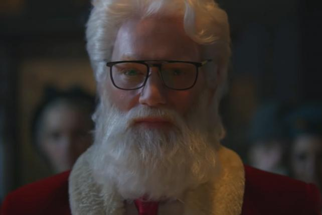 Santa sheds pounds to fit in a sports car in Audi ad