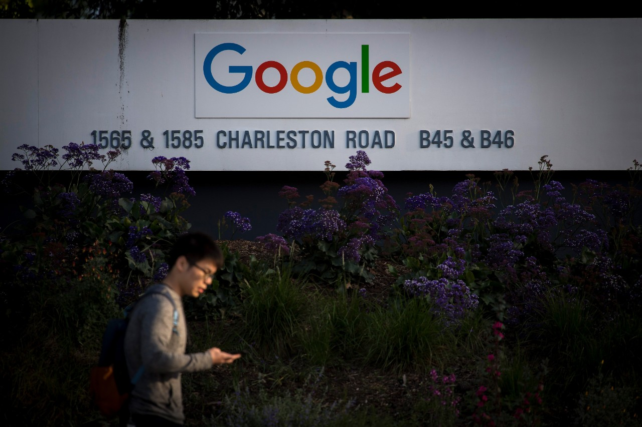 Google's parent company reports a drop in profits, while ad sales rise