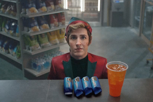 An elf's first Christmas includes a snack stop at a convenience store for Oreo cookies