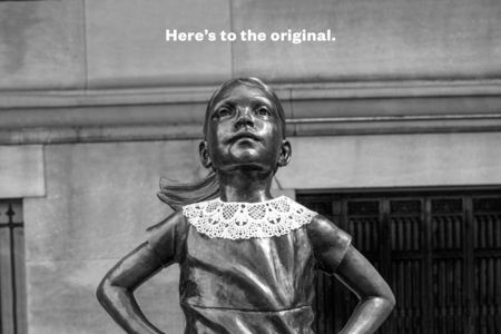 'Fearless Girl' dons a lace collar in tribute to Ruth Bader Ginsburg