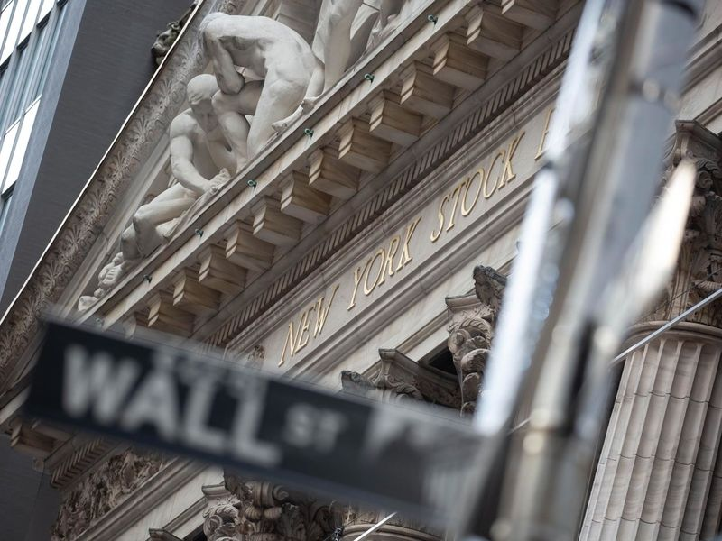 Wall Street's frothy mood smacks brands like Macy's and Blockbuster, plus Facebook jabs Apple: Thursday Wake-Up Call