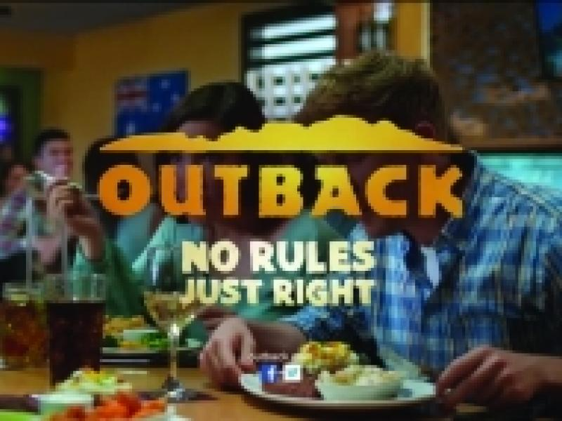 """A grainy AF screencap of an Outback Steakhouse commercial with the outback logo and """"NO RULES JUST RIGHT"""" over the image of some people eating some grainy food."""