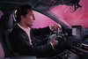Matthew McConaughey drives through a purple cloud in his latest for Lincoln