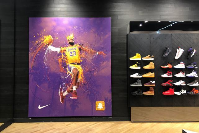 0a0f3060148 LeBron James jumped off this poster into a Snapchat augmented reality  promotion last month.
