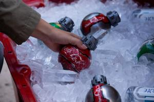 Coke to sell droid-like bottles at new Star Wars theme parks
