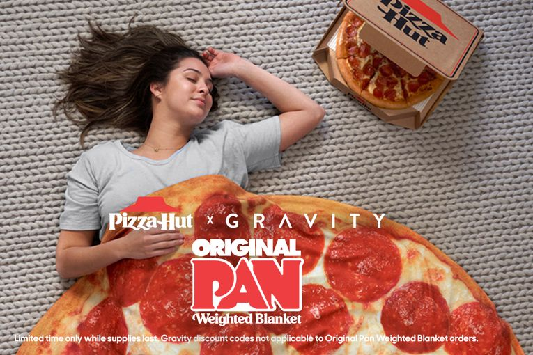 Pizza Hut's pie-shaped Gravity Blanket is 15 pounds of anxiety-absorbing comfort