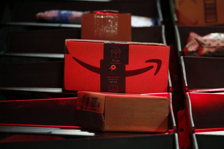 One-day shipping a holiday gift for Amazon as revenue rises