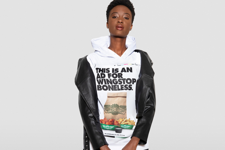 Wingstop moves its out-of-home budget into hoodies—and pays fans to wear them