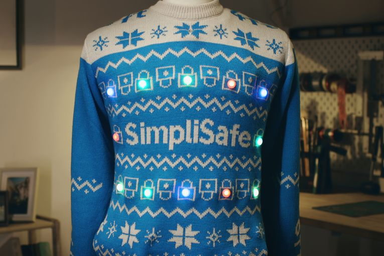 Simplisafe's ugly Christmas sweater starts blaring when people come (unsafely) close to you