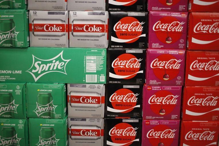 Coca-Cola rises as sales inch back