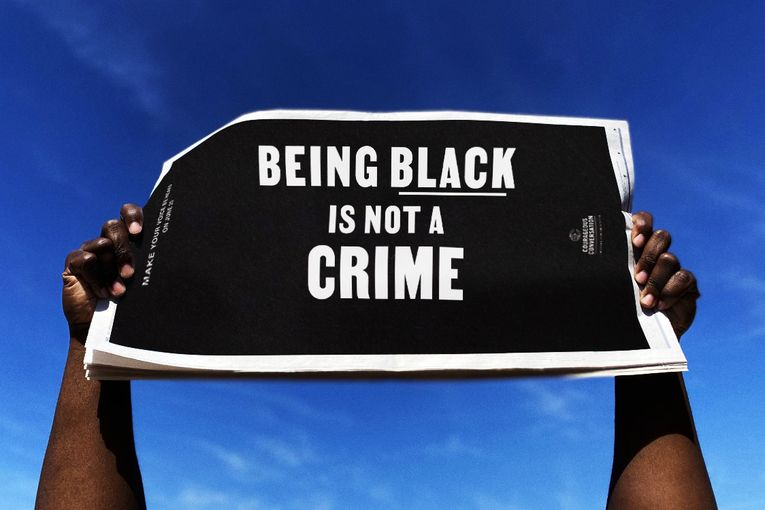 Courageous Conversation Global Foundation: Being Black Is Not a Crime Newspaper Sign