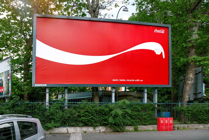These Coke billboards point you to the nearest recycling bin